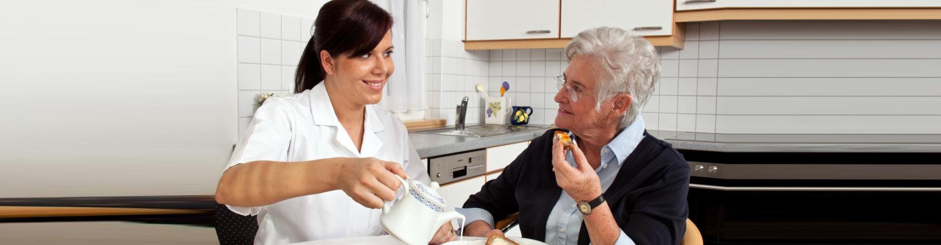 caregiver and senior woman eating