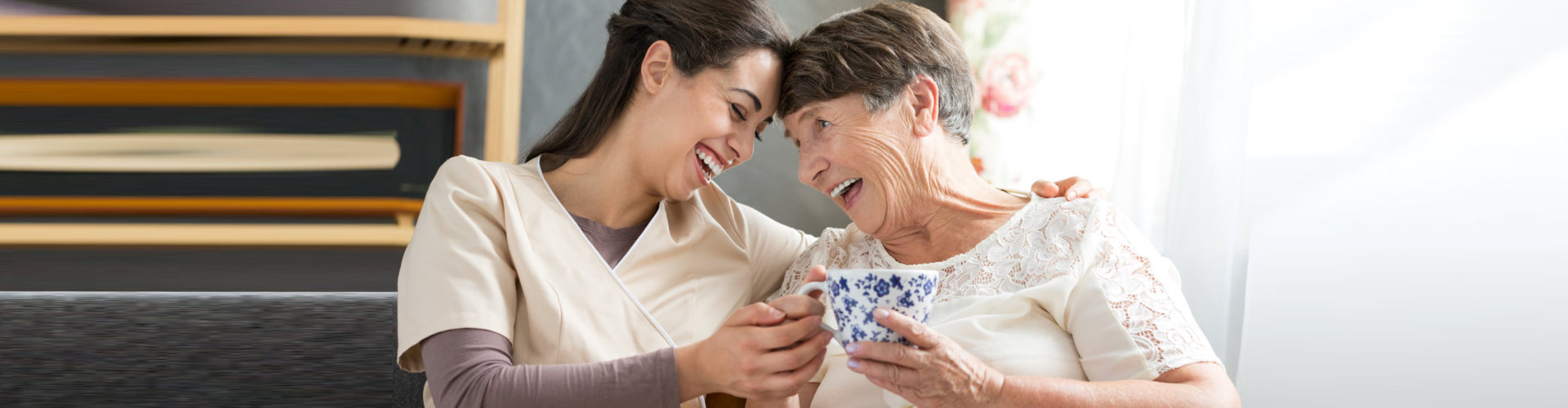 happy caregiver and senior woman